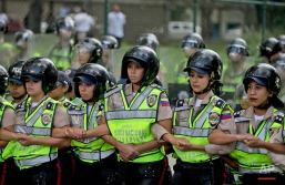 Bolivarian National Police officers create a human barrier to stop a protest march by university students, in Caracas, Venezuela, Thursday, May 26, 2016. The public university students marched to demand that the government provide more resources and avoid closing centers of study. (AP Photo/Fernando Llano)