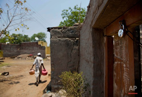 In this May 10, 2016, photo, a locked house is seen as people have fled to cities for work due to drought in Masurdi village in Marathwada region , in the Indian state of Maharashtra. Failed monsoons play havoc with millions of farmers in central India leading to crippling poverty and soaring suicides. Some 400 farmers have killed themselves so far this year in the parched Marathwada region, which is home to about 19 million people. (AP Photo/Manish Swarup)