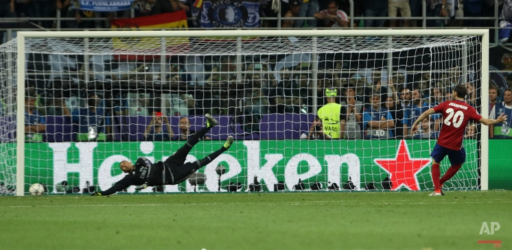 Atletico's Juanfran misses a penalty during the Champions League final soccer match between Real Madrid and Atletico Madrid at the San Siro stadium in Milan, Italy, Saturday, May 28, 2016. Real Madrid won 5-4 on penalties after the match ended 1-1 after extra time. (AP Photo/Luca Bruno)