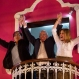 Presidential candidate Pedro Pablo Kuczynski, center, celebrates with his running mates for first and second vice-presidents Martin Vizcarra, left, and Mercedes Araoz, right, from the balcony of their headquarters in Lima, Peru, Sunday, June 5, 2016. Early exit polls show presidential candidate Pedro Pablo Kuczynski with a slight lead over his rival Keiko Fujimori in Peru's runoff presidential election. (AP Photo/Rodrigo Abd)