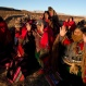 Aymara indigenous hold up their hands to receive the first rays of sunlight in a New Year's ritual in the ruins of the ancient city Tiwanaku, Bolivia, early Tuesday, June 21, 2016. Bolivia's Aymara Indians are celebrating the year 5,524 as well as the Southern Hemisphere's winter solstice, which marks the start of a new agricultural cycle. (AP Photo/Juan Karita)