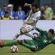 Argentina's Ezequiel Lavezzi, left, and Bolivia's Pedro Azogue fight for the ball during a Copa America Centenario Group D soccer match, Tuesday, June 14, 2016, at CenturyLink Field in Seattle. (AP Photo/Elaine Thompson)