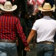 A couple walk hand in hand to the site of the annual gay pride parade in Mexico City, Saturday, June 25, 2016. Thousands of people marched down Paseo de la Reforma for one of the largest gay pride events in Latin America. (AP Photo/Marco Ugarte)go to see the march