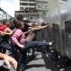 A woman kicks the shield of a National Guard soldier as other demonstrators push during a protest demanding food, a few blocks from Miraflores presidential palace in Caracas, Venezuela, Thursday, June 2, 2016. Venezuela is seeing rising frustration with widespread food shortages and triple-digit inflation. (AP Photo/Ariana Cubillos)