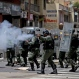 Bolivarian National Guards fire rubber bullets at people protesting for food, a few blocks from Miraflores presidential palace in Caracas, Venezuela, Thursday, June 2, 2016. Venezuela is seeing rising frustration with widespread food shortages and triple-digit inflation. (AP Photo/Fernando Llano)