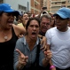 A woman who had been standing in line outside a validation center to certify the authenticity of her signature for a referendum to recall President Nicolas Maduro, becomes angry after learning that the center closed at the appointed hour, without attending those still standing in line, in Caracas, Venezuela, Friday, June 24, 2016. For the fifth consecutive day thousands of opposition supporters gathered at polling stations to validate their forms in the final phase of the process that will be crucial in order to realize a possible recall referendum against Maduro. The government had promised to keep the centers opened attending those still standing in line. (AP Photo/Fernando Llano)