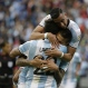 Argentina's Victor Cuesta, center, is congratulated by Ezequiel Lavezzi, front, and Ramiro Funes Mori after scoring his side's third goal against Bolivia during a Copa America Centenario Group D soccer match, Tuesday, June 14, 2016, at CenturyLink Field in Seattle. (AP Photo/Elaine Thompson)