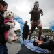 A man kisses a statue of soccer star Lionel Messi shortly after it was unveiled in Buenos Aires, Argentina, Tuesday, June 28, 2016. Fans, players, and even Argentina's President Mauricio Macri and the country's greatest player Diego Maradona have asked Messi to reconsider his decision to resign from the national team after losing the Copa America final to Chile. (AP Photo/Victor R. Caivano)