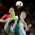 Belgium's Kevin De Bruyne, right, fights for the ball with Hungary's Adam lang during the Euro 2016 round of 16 soccer match between Hungary and Belgium, at the Stadium municipal in Toulouse, France, Sunday, June 26, 2016. (AP Photo/Ariel Schalit)