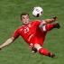 Switzerland's Xherdan Shaqiri scores on an acrobatic kick during the Euro 2016 round of 16 soccer match between Switzerland and Poland, at the Geoffroy Guichard stadium in Saint-Etienne, France, Saturday, June 25, 2016. (AP Photo/Michael Sohn)