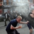 English fans run for cover after getting sprayed with pepper spray by French police during scuffles in downtown Lille, northern France, Wednesday, June 15, 2016, one day ahead of the Euro 2016 Group B soccer match against Wales in nearby Lens. Russia were playing Slovakia at the Pierre Mauroy stadium in Villeneuve d'Ascq, near Lille on Wednesday which raised the possibility of violence after clashes between supporters from the two countries at their previous match in Marseille last weekend. (AP Photo/Michel Spingler)