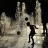 A young boy cools off under a water fountain as he plays with two balls on a sunny day, in Pamplona northern Spain,Wednesday, June 8, 2016. The recent hot weather has prompted many people to cool off in the water fountains. (AP Photo/Alvaro Barrientos)
