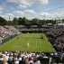 Milos Raonic of Canada plays Pablo Carreno Busta of Spain during their men's singles match on day one of the Wimbledon Tennis Championships in London, Monday, June 27, 2016. (AP Photo/Tim Ireland)