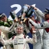 The Porsche 919 Hybrid No2 of the Porsche Team driven by Neel Jani of Switzerland, Romain Dumas of France, Marc Lieb of Germany and Coach driver Jeromy Moore celebrate with champagne, after winning the 84th 24-hour Le Mans endurance race, in Le Mans, western France, Sunday, June 19, 2016. (AP Photo/Kamil Zihnioglu)