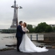 A Chinese couple has a wedding photograph taken on the flooded banks of the Seine river in front of the Eiffel Tower in Paris, Friday, June 3, 2016. Both the Louvre and Orsay museums were closed as the Seine, which officials said was at its highest level in nearly 35 years, was expected to peak later Friday. (AP Photo/Jerome Delay)