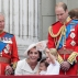 Britain's Prince William, right, his son Prince George, front, and Kate, Duchess of Cambridge holding Princess Charlotte, centre, with The Prince of Wales, left, on the balcony during the Trooping The Colour parade at Buckingham Palace, in London, Saturday, June 11, 2016. Hundreds of soldiers in ceremonial dress have marched in London in the annual Trooping the Colour parade to mark the official birthday of Queen Elizabeth II. (AP Photo/Tim Ireland)