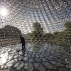 A worker cleans the floor of British artist Wolfgang Buttress' 17 metre high bee health inspired 'The Hive' aluminum installation as it stands on display after being put up in Kew Royal Botanic Gardens west London, Wednesday, June 15, 2016. The installation is fitted with LED lights and a unique sound accompaniment that respond to the real-time activity of bees in a beehive behind the scenes. The sound and light intensities change as the energy levels in the real beehive surge, giving visitors an insight into life inside a bee colony. (AP Photo/Matt Dunham)
