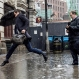 A man jumps over a puddle outside Victoria Station, as heavy rain falls, in London, Monday June 20, 2016. Monday marks the Summer Solstice - the longest day of the year and the astronomical change of seasons when days are longest and nights are shortest in the Northern Hemisphere. (Lauren Hurley/PA via AP)