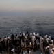 Migrants look out from the stern of the 'Aquarius' vessel, Saturday June 25, 2016, on the Mediterranean Sea, as more than 600 migrants are aboard the ship rescued by SOS Mediterranee and the medical aid group Medecins Sans Frontieres (MSF). The organizations cooperate during search and rescue operations for migrants and refugees from boats in distress in the Mediterranean Sea. (AP Photo/Bram Janssen)