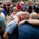 People gather for a vigil in memory of the victims of the Orlando, Fla., worst mass shooting in modern U.S. history, Monday, June 13, 2016, at City Hall in Philadelphia. A gunman opened fire inside a crowded gay nightclub early Sunday, before dying in a gunfight with SWAT officers, police said. (AP Photo/Matt Rourke)