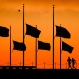 Runners pass under the the flags flying at half-staff around the Washington Monument at daybreak in Washington, Monday, June 13, 2016. The flags were ordered to half-staff by President Barack Obama to honor the victims of the Orlando nightclub shootings. (AP Photo/J. David Ake)