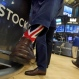Specialist Michael Pistillo wears Union Jack socks as he works on the floor of the New York Stock Exchange, Friday, June 24, 2016. U.S. stocks are plunging in early trading after Britons voted to leave the European Union. (AP Photo/Richard Drew)