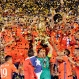 Chile players celebrate with their trophy after the Copa America Centenario championship soccer match, Sunday, June 26, 2016, in East Rutherford, N.J. Chile defeated Argentina 4-2 in penalty kicks to win the championship. (AP Photo/Julie Jacobson)