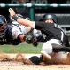 Chicago White Sox's Adam Eaton, right, slides safely into home to score on a single by Jose Abreu as Minnesota Twins catcher Kurt Suzuki dives too late to make the tag during the third inning of a baseball game in Chicago, Thursday, June 30, 2016. (AP Photo/Nam Y. Huh)
