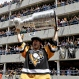 Pittsburgh Penguins' Kris Letang holds the Stanley Cup overhead in front of some of the crowd packing a parking lot along the victory parade route in Pittsburgh, Pa., Wednesday, June 15, 2016. The Penguins defeated the San Jose Sharks on Sunday to win the NHL hockey championship. (AP Photo/Keith Srakocic)