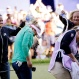 Brooke Henderson, of Canada, second left, and her caddy and sister Brittany Henderson are doused with water and sports drinks on the 18th green after Brooke Henderson won the Women's PGA Championship golf tournament at Sahalee Country Club on Sunday, June 12, 2016, in Sammamish, Wash. (AP Photo/Elaine Thompson)