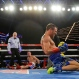 Vasyl Lomachenko, front right, of Ukraine, celebrates after knocking down Roman Martinez, back center, of Puerto Rico, in the fifth round of a WBO junior lightweight title boxing match Saturday, June 11, 2016, in New York. Lomachenko stopped Martinez in the fifth round.(AP Photo/Frank Franklin II)