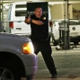 A police officer yells and aims his pistol as he stops a driver in downtown Dallas on Thursday, July 7, 2016, after police officers were shot and killed during a protest over fatal police shootings of black men in other states. (AP Photo/LM Otero)
