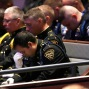 Law enforcement officers bow their heads in prayer during funeral services for Dallas Police Sr. Cpl. Lorne Ahrens at Prestonwood Baptist Church in Plano, Texas, Wednesday, July 13, 2016. Ahrens and four other officers were slain by a sniper during a protest last week in downtown Dallas. (AP Photo/LM Otero)