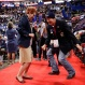 Oklahoma alternate delegate Debbie House, left, and delegate Allie Burgin dance before the start of the third day session of the Republican National Convention in Cleveland, Wednesday, July 20, 2016. (AP Photo/Matt Rourke)