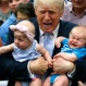 Republican presidential candidate Donald Trump holds Kellen Campbell of Denver, right, and Evelyn Keane, of Castle Rock, Colo., during a campaign rally, Friday, July 29, 2016, in Colorado Springs, Colo. (AP Photo/Evan Vucci)