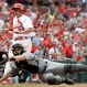 St. Louis Cardinals' Aledmys Diaz, top, scores as Miami Marlins catcher Jeff Mathis reaches for the throw during the sixth inning of a baseball game Sunday, July 17, 2016, in St. Louis. (AP Photo/Jeff Roberson)
