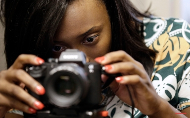 CORRECTS NAME TO BRIANA LAWRENCE, INSTEAD OF BRIANNA LAWRENCE Briana Lawrence, 21, adjusts a camera in a studio at North Carolina Central University in Durham, N.C., on Thursday, July 14, 2016. She was just 7 on Sept. 11, 2001 and the immediate aftermath of the terrorist attacks is the only time she can remember the nation feeling united, even if only by grief. (AP Photo/Gerry Broome)