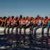 In this Tuesday July 19, 2016 photo, refugees and migrants from Eritrea, Mali, Bangladesh and other countries wait on board a dinghy to be rescued in the Mediterranean Sea, 27 kilometers (17 miles) north of Sabratha, Libya. (AP Photo/Santi Palacios)