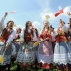 A group of folk dancers rehearse prior to the arrival of Pope Francis at the military airport in Krakow, Poland, Wednesday, July 27, 2016. Pope Francis is traveling to Poland to meet young Catholics from around the globe and visit the Auschwitz death camp and many Catholic places in this deeply religious nation. It will be the pope's first visit to central or Eastern Europe. (AP Photo/Alik Keplicz)
