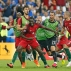 Portugal's Eder, centre, celebrates after scoring the opening goal during the Euro 2016 final soccer match between Portugal and France at the Stade de France in Saint-Denis, north of Paris, Sunday, July 10, 2016.(AP Photo/Michael Probst)