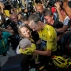 2016 Tour de France champion, Britain's Chris Froome, wearing the overall leader's yellow jersey, is congratulated by his wife Michelle, who holds their baby boy, after the twenty-first stage of the Tour de France cycling race over 113 kilometers (70.2 miles) with start in Chantilly and finish in Paris, France, Sunday, July 24, 2016. (AP Photo/Christophe Ena)