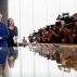 Photographers and television cameras cover German Chancellor Angela Merkel as she leaves a news conference in Berlin, Germany, Thursday, July 28, 2016. Second left is Angela Wefers, the journalist who led the news conference. (AP Photo/Markus Schreiber)