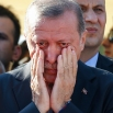 Turkish President Recep Tayyip Erdogan right, wipes his tears during the funeral of Mustafa Cambaz, Erol and Abdullah Olcak, killed Friday while protesting the attempted coup against Turkey's government, in Istanbul, Sunday, July 17, 2016. Rather than toppling Turkey's strongman president, a failed military coup appears to have bolstered Erdogan's immediate grip on power and boosted his popularity. (AP Photo/Emrah Gurel)