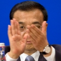 Chinese Premier Li Keqiang applauds as he attends the 11th EU-China Business Summit at the Great Hall of the People in Beijing, Wednesday, July 13, 2016. (AP Photo/Ng Han Guan, Pool)