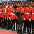 A Thai army officer adjusts the belt of a member of the honor guard in preparation for the arrival of Laos Prime Minister Thongloun Sisoulith at the government house in Bangkok, Thailand, Wednesday, July 6, 2016. Thongloun is on a two-day visit to Thailand. (AP Photo/Sakchai Lalit)