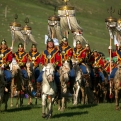 Mongolian horsemen ride across a field during a shortened version of a Naadam festival, a traditional Mongolian cultural and sporting event, held during the 11th Asia-Europe Meeting (ASEM) in Ulaanbaatar, Mongolia, Friday, July 15, 2016. (AP Photo/Mark Schiefelbein)