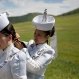 A Mongolian performer helps another with her hair before a shortened version of a Naadam festival, a traditional Mongolian cultural and sporting event, held during the 11th Asia-Europe Meeting (ASEM) in Ulaanbaatar, Mongolia, Friday, July 15, 2016. (AP Photo/Mark Schiefelbein)