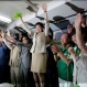Former defense minister Yuriko Koike, center, and her supporters celebrate during her gubernatorial election victory at her election office in Tokyo, Sunday, July 31, 2016. Tokyo on Sunday elected its first female governor to lead the city as it prepares to host the 2020 Olympics. (AP Photo/Shizuo Kambayashi)