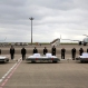 Japanese Foreign Minister Fumio Kishida, third left, with other officials, bows in front of the coffins of the victims who were killed in the July 2 attack in Bangladeshi capital Dhaka, at Haneda Airport in Tokyo, Tuesday, July 5, 2016. The bodies of the Japanese victims arrived Tuesday morning in Tokyo on a Japanese government airplane. (AP Photo/Shizuo Kambayashi)