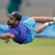 Indian cricket team captain Virat Kohli dives to catch the ball on the last day of team's six day training camp at National Cricket Academy in Bangalore, India, Monday, July 4, 2016. Indian team is scheduled to travel to West Indies' to play four match test series starting July 21. (AP Photo/Aijaz Rahi)